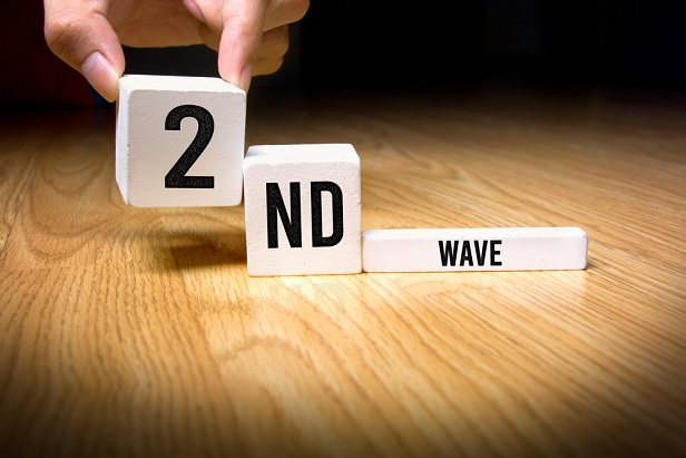 hand putting a block labeled 2 next to others with ND and Wave on them