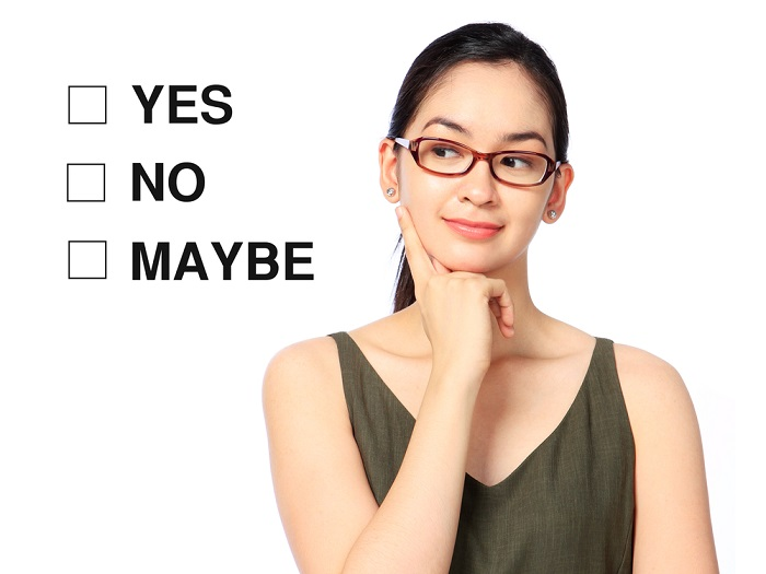 young woman thinking about 3 checkboxes that say yes, no, maybe