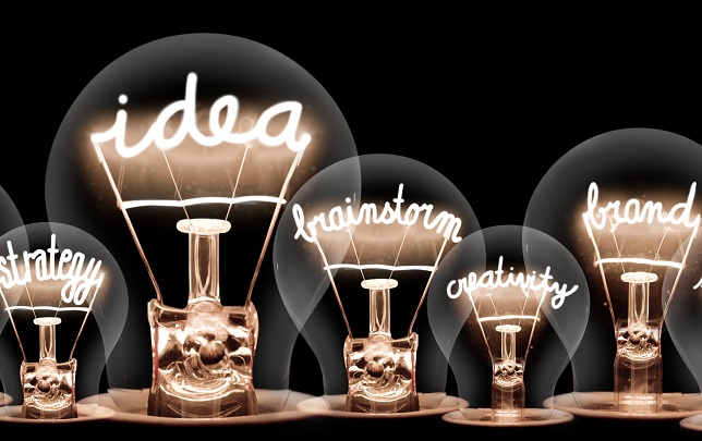 light bulbs with words written in them in neon including idea and brand