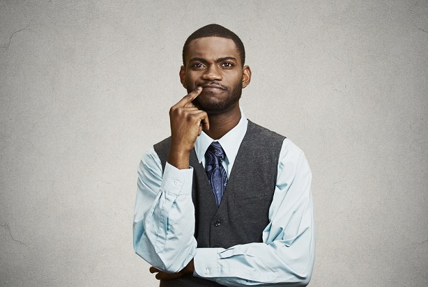 Business man with elbow on hand thinking and deciding