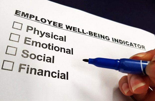hand with pen hovering over 4 checkboxes under title of employee well being indicators