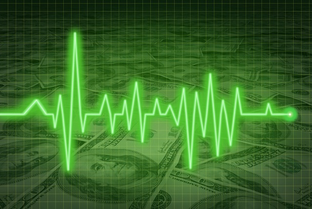 Green ekg heart line on a background of US currency
