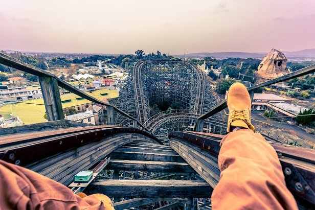 real or faked shot from viewpoint of man sitting at top of rollercoaster rail track