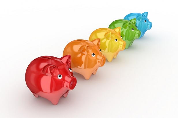 multiple piggy banks in a row in different colors