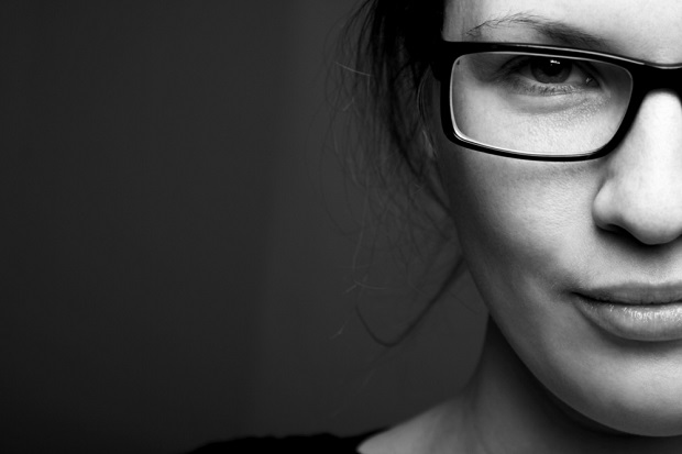 cropped half of young woman's face in black and white