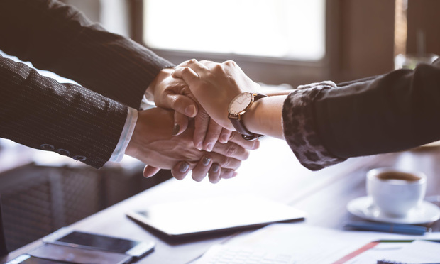 Business trust commitment which Business Partners holding hands with Help, trust ,support ,empathy and factors relationship marketing for reach successful achievement and meeting commit concept..