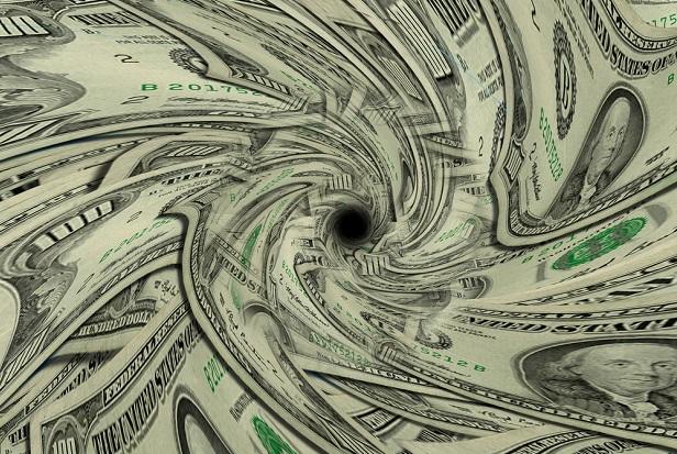 dollar bills forming a drain