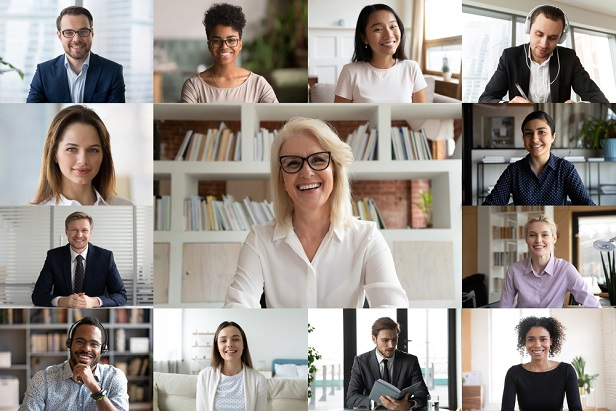 older female employee on video meeting surrounded by coworkers' photos