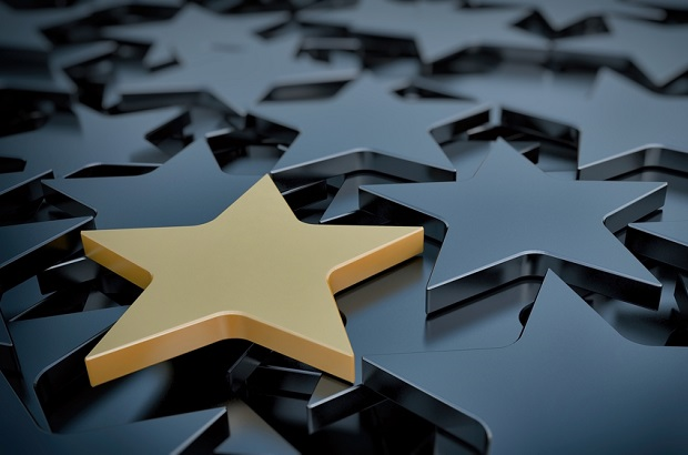 gold star on background of black stars