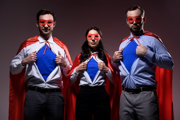 3 business people opening shirts to show their super costume plus all wearing capes