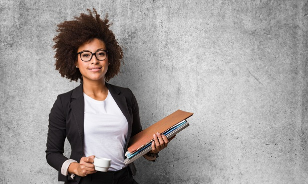 business woman holding folder and cup of coffee