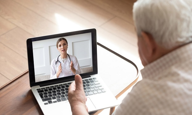 Man and doctor, telehealth appointment