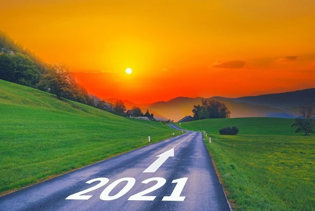 road with 2021 on it and arrow pointing to mountains and sunset or sunrise