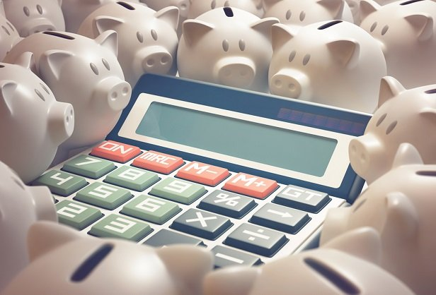 many white piggy banks surrounding a large calculator