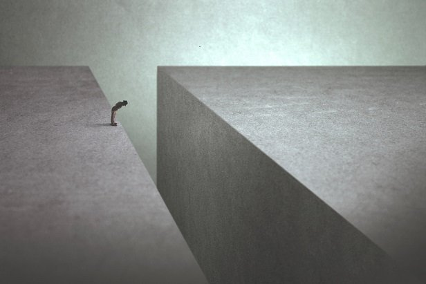drawing of tiny person at edge of gap between big concrete-like blocks
