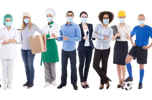 group of masked employees dressed in various uniforms and work clothes