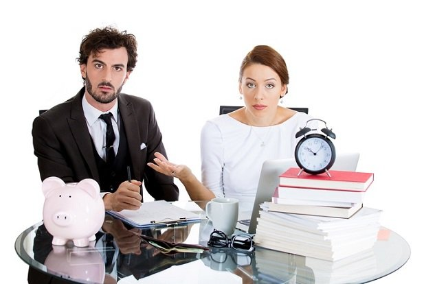 man and woman with piggy bank looking surprised and exasperated