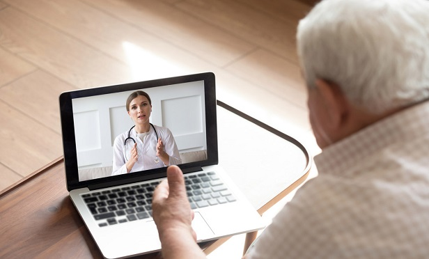 Man speaking to a healthcare provider via computer.