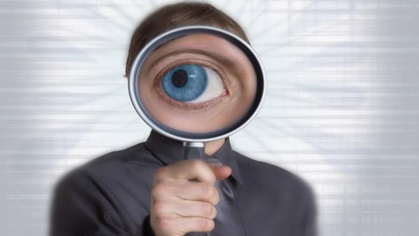 Eye through a magnifying glass