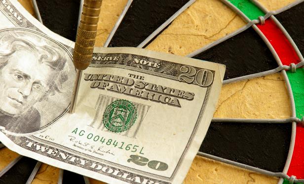 $20 bill on dartboard