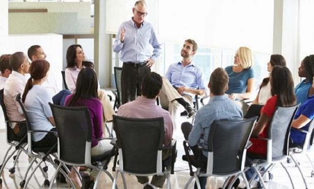 Businessman Addressing Staff Meeting
