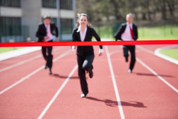 business people running a race