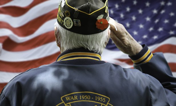 Old veteran slauting the flag.