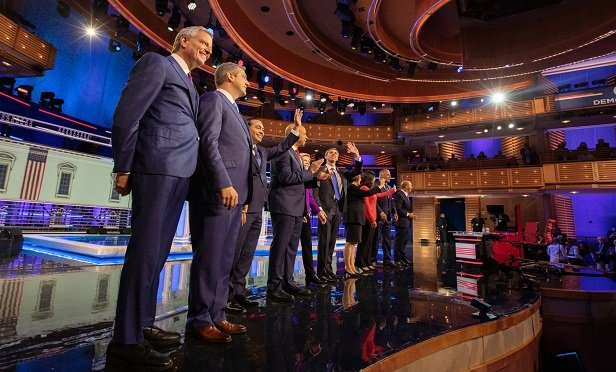 2020 Democratic presidential candidates, from left: Bill de Blasio, mayor of New York City; Rep. Tim Ryan, a Democrat from Ohio; Julian Castro, former secretary of Housing and Urban Development (HUD); Sen. Cory Booker, a Democrat from New Jersey; Sen. Elizabeth Warren, a Democrat from Massachusetts; Beto O'Rourke, former representative from Texas; Sen. Amy Klobuchar, a Democrat from Minnesota; Rep. Tulsi Gabbard, a Democrat from Hawaii; Jay Inslee, governor of Washington; and former Rep. John Delaney of Maryland. (Photo: Jayme Gershen/Bloomberg)