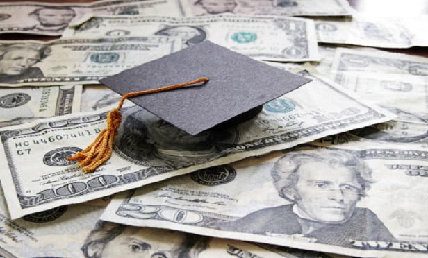A mortarboard on money
